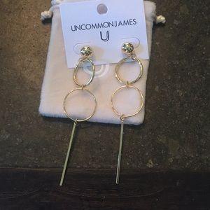 Uncommon James Baller earrings in gold.